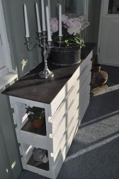 A gorgeous unique console create by reusing old pallets! DIY at its finest.
