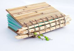 Handbound blank book with beaver chewed branches, bamboo covers and wooden beads $41
