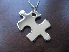 Puzzle Heart Silver Pendant Necklace. £42.00, via Etsy. Perfect gift for a mom with an autistic son/daughter.