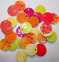 paper charms for jewlry diy using scrapbook paper and modpodge
