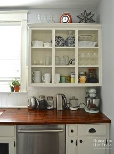 House on the Fritz blog Kitchen Reno. Cabinet paint - Sherwin Williams Dover White 6385.