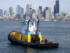 Seattle tug boat and skyline by mecb, via Flickr