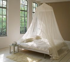 """This King Size Mosquito Net has a canopy top, a circumference of 1400cm – 45'11""""ft/in and a height of 265cm – 8'8""""ft/in. It is suspended from a single point above the bed and is suitable for queen- an"""