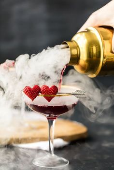 You need LOVE POTION MARTINI for Valentines Day! This is the cutest Valentines Day Cocktail! Triple Berry Martini tastes great, is beautiful, and EASY! Made with dry ice, this is such a fun and festive Valentines Day pink drink! Valentines Day Food, Valentine Drinks, Valentine Party, Pink Cocktails, Pink Drinks, Dry Ice Cocktails, Valentine's Day Drinks, Yummy Drinks, Beverages
