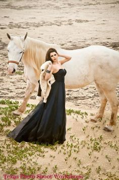 Model liz with Horse at Madagordia Beach in Texas.  This was a Equine Fantasy Fashion Photography Workshop listed on thephotobinder.com