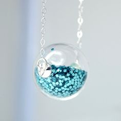 Teal glitter in hand blown glass ball  silver by thestudio8