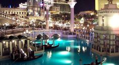 Gondola rides in Las Vegas at the Ventian hotel - at night, when the Venetian is all lit up for the night..