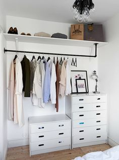 Combined dressers and hangers. Great use of space in walk in closet.