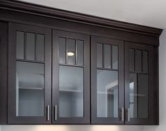Black Mission style cabinets with mullion doors and glass inserts