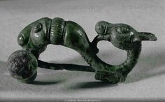 Double-headed animal. Bronze fibula (around 400 BCE) Length 8 cm (c) Photograph by Erich Lessing celtic