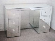 I've decided to downgrade from a mirrored bed, to a mirrored desk.