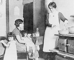 1918:A public health nurse teaches a young mother how to sterilize a bottle. [Credit: National Library of Medicine]