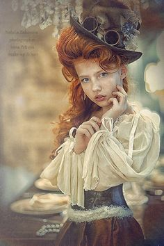 Love the huge hat and huge hair, ruffles, outside, pose. Love it all. No idea if it is practical for our purposes though