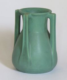 Lot: Teco 4-Handle Buttress Matte Green Buttress Vase, Lot Number: 0001, Starting Bid: $2,500, Auctioneer: California Historical Design, Auction: Acstickley Arts & Crafts Auction, Date: July 13th, 2014 CDT