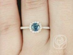 Rosados Box Ready to Ship Kubian Rose Gold Round Teal Sapphire and Diamonds Round Halo Engagement Ring - Moyiki Sites Engagement Ring Buying Guide, Round Halo Engagement Rings, Jewelry Stores Near Me, Diamond Wedding Sets, Love, Sapphire Diamond, Fashion Rings, Wedding Rings, Jewellery Shops