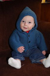 This sweet baby hoodie is the perfect cardigan to keep your child snuggly warm. (Lion Brand Yarn)