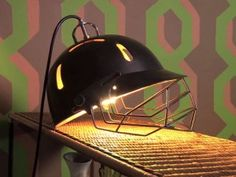 Cricket helmet lamp - Step By Step - Kirstie Allsopp helps people transform their homes with furniture that's been sourced for free -  http://www.channel4.com/programmes/kirsties-fill-your-house-for-free/articles