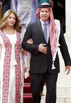 Jordan's King Abdullah II's brother Prince Feisal walks alongside his wife Princess Zeina during a ceremony to celebrate the country's 69th Independence Day, in Amman, on May 25, 2015.