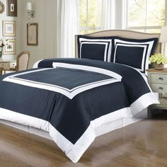 Modern Hotel Style Navy Blue and White 100 percent Egyptian Cotton Framed Duvet Cover and Shams Set. Made of 300 thread count cotton. The bedding set is contrasted with a White frame pattern for a chic 5 Stars hotel look.