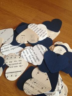 Paper hearts in place of flower petals for a books and music themed wedding