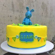 "Fondant Cake i made for my son's birthday. He loves ""Kikaninchen"" the little blue bunny... Inside was a lime-mango yoghurtcreame!"
