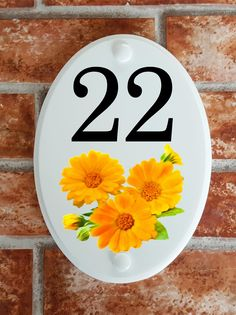 A range of pottery style house plaques feature prints of original artwork from our own sign artists. Hand cast in cultured marble these number plates are weatherproof outdoors. House Plaques, House Number Plaque, House Numbers, Calendula, Floral Motif, Original Artwork, Decorative Plates, Pottery, Flowers