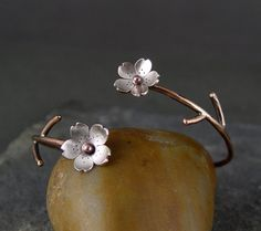 Cherry Blossom Bronze Cuff, Sakura bracelet, Spring Flower Cuff, Gifts for Mom, Gifts for her, Silver Plum Cuff. $50.00, via Etsy.