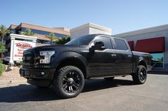 """This custom 2015 Platinum F-150 has a 2.25"""" Traxda Front Leveling Kit. 20x9 XD Monster Matte Black Wheels on LT305/55R20 Toyo Open Country A/TII 's. We also installed a Magnaflow Cat Back Exhaust System and a Pace Edwards Electric Bedcover. To top it off we painted almost every inch of the car that was not already black and smoking the Taillights."""
