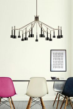 A retro lamp, it's diffusers have simple lines that lend to the atmosphere a sense of balance and freshness. Here represented in the suspension version. Its structure is made in brass and the lampholders in aluminium.  www.delightfull.e...