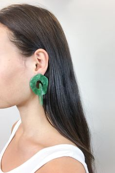 These chunky emerald green jewel statement dangling earrings are exactly what you need to dress up that Summer 2018 outfit.