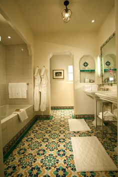 A Spanish romantic-style bathroom with a vanity made of an antique stone basin a… – The Best Spanish Bathroom Designs,Tips and Images Spanish Style Decor, Spanish Style Homes, Spanish Revival, Spanish House, Spanish Colonial, Spanish Bungalow, Spanish Modern, Spanish Bathroom, Spanish Style Bathrooms