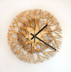 Tree shaped wooden laser cut wall clock by ModernOakWorkshopmy favorite new purchase:)