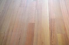 Red oak floors sealed with oil. I really like the look, I bet it'd be great for the walls