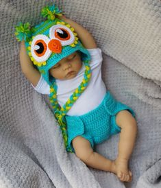 Check out this cute crochet baby owl hat and diaper cover set! This crochet diaper cover and owl infant hat with ear flaps and braids are great for new