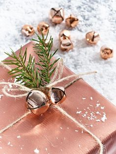 50 of the most beautiful Christmas gift wrapping ideas (with stacks of free Jingle bells. Copper and bell Christmas gift wrapping. You'll literally jingle all the way with this adorable gift wrap idea using oversized jin. Christmas Bells, Christmas Colors, Winter Christmas, Christmas Holidays, Christmas Ideas, Rose Gold Christmas Decorations, Christmas Flatlay, Rose Gold Christmas Tree, Christmas Kitchen