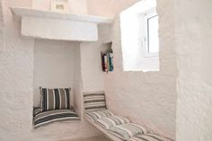 Restored trullo for sale: interior design and project by Apulia Proprerty Design