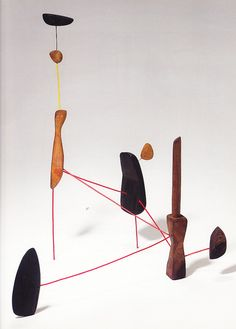 Calder, Constellation with Red Knife, 8 ft, wire + sculpture (rock and wood). artist statement: graphic line and space