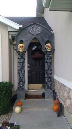 Halloween-DIY Faux Mausoleum.  The skulls' eyes blink!