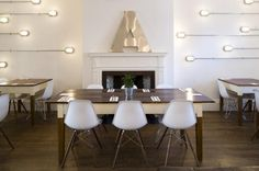 Amelie and Friends, outdoor lights indoors, flush mount lighting on wall, white Eames chairs, wood and white