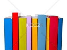 bright books - Brightly coloured books of various sizes lined up.