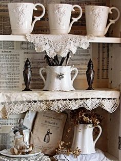 Lovely cottage kitchen....love the patchwork of papers instead of paint.....