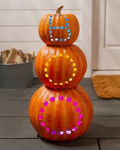 Give your trick-or-treaters a spooky greeting while lighting up your porches with this lively stack of pumpkins.