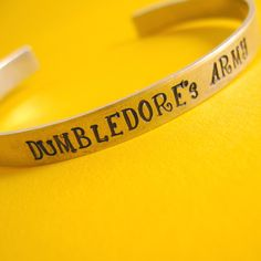 Harry Potter Bracelet Dumbledore's Army  Hand by SpiffingJewelry, $18.00  I would so wear this!