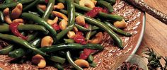 Perk up green beans with an Asian flair - teriyaki baste and glaze, mustard and crunchy cashews.
