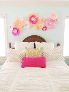 I think I'll order these ones! Set of 12 Tissue Paper Flowers for Wall Decor in Pink and Gold Foil on Etsy, $85.00