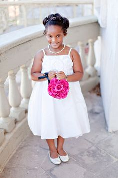 adorable flower girl with pomander | Ivy Weddings