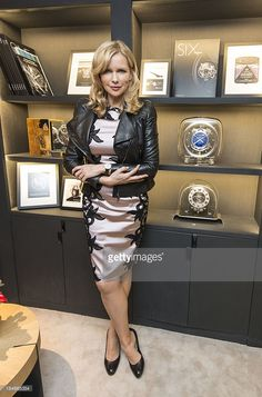 Actress Veronica Ferres poses withe the long case clock 'Atmos 566' during the Jaeger-LeCoultre Boutique Opening on October 14, 2013 in Frankfurt am Main, Germany.