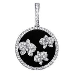 Caresse d'Orchidées par Cartier earrings. White gold, onyx, diamonds. PHOTO: Vincent Wulveryck © Cartier 2011