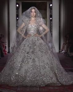 Zuhair Murad Look Collection Couture Automne Hiver Uniq Silver Embroidered Strapless A-Lane Princess Wedding Dress / Bridal Ball Gown with Veil and Long Train. Runway Show by Zuhair Murad - Magazine Long Wedding Dresses, Bridal Dresses, Wedding Gowns, Zuhair Murad Wedding Dresses, Zuhair Murad Bridal, Luxury Wedding Dress, Ball Gown Dresses, Lace Wedding, Couture Dresses