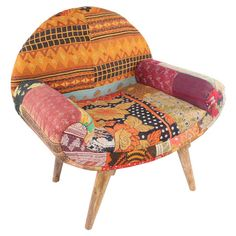 Add an exotic touch to your living room or home library with this eye-catching arm chair, showcasing vintage kantha cloth upholstery and a mango wood frame.